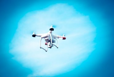 An image of a drone flying in the sky